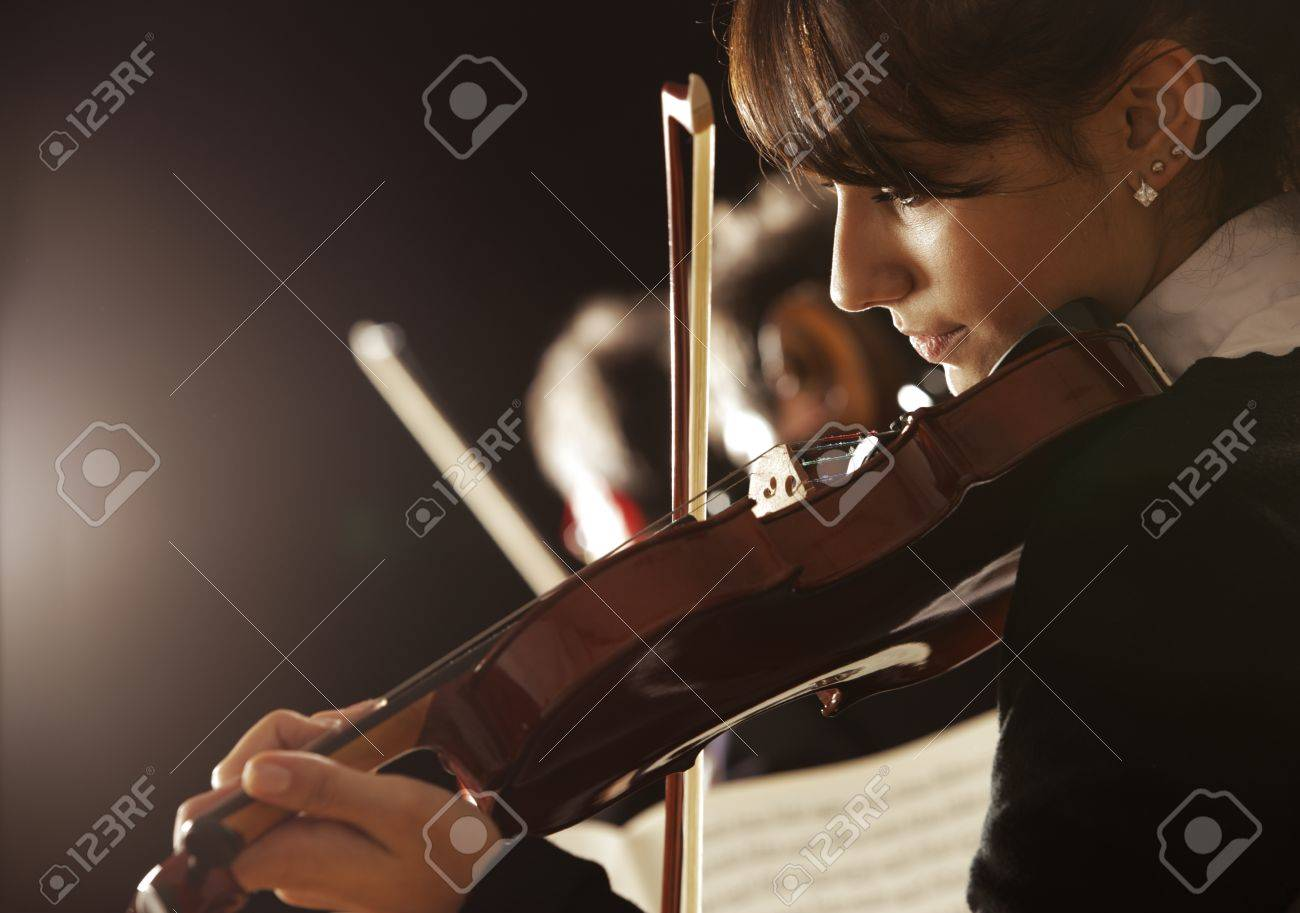 Violinist woman playing a concert of classical music Stock Photo - 16661740