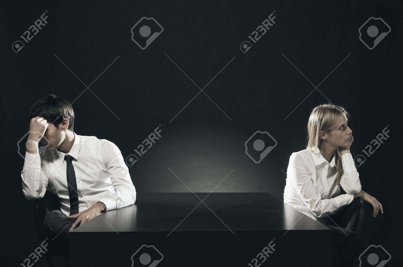 An unhappy or bored couple sitting apart Stock Photo - 16661672