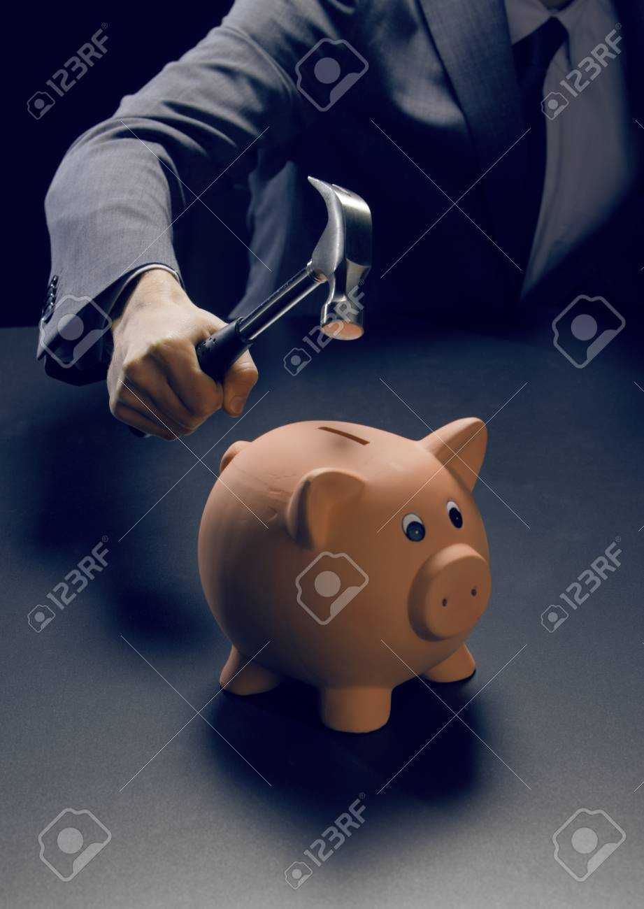 Hammer about to smash piggy bank Stock Photo - 17070657