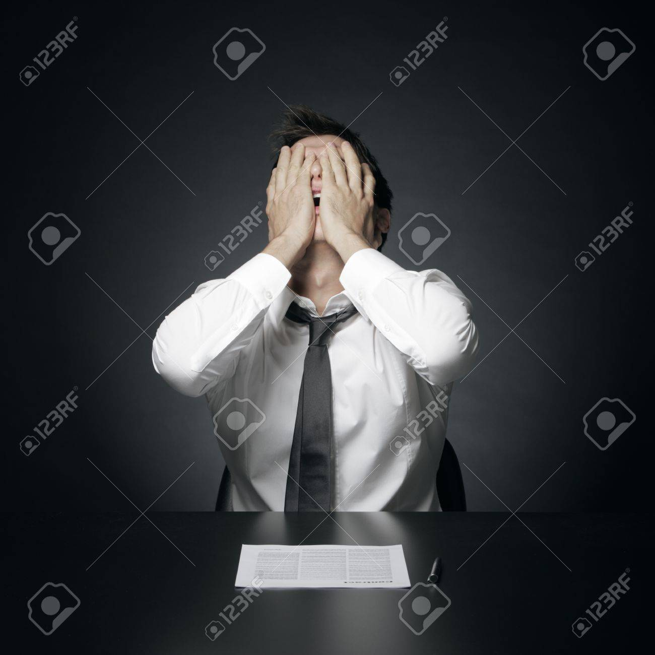 portrait of desperate office manager  covering his face with both hands Stock Photo - 17054004