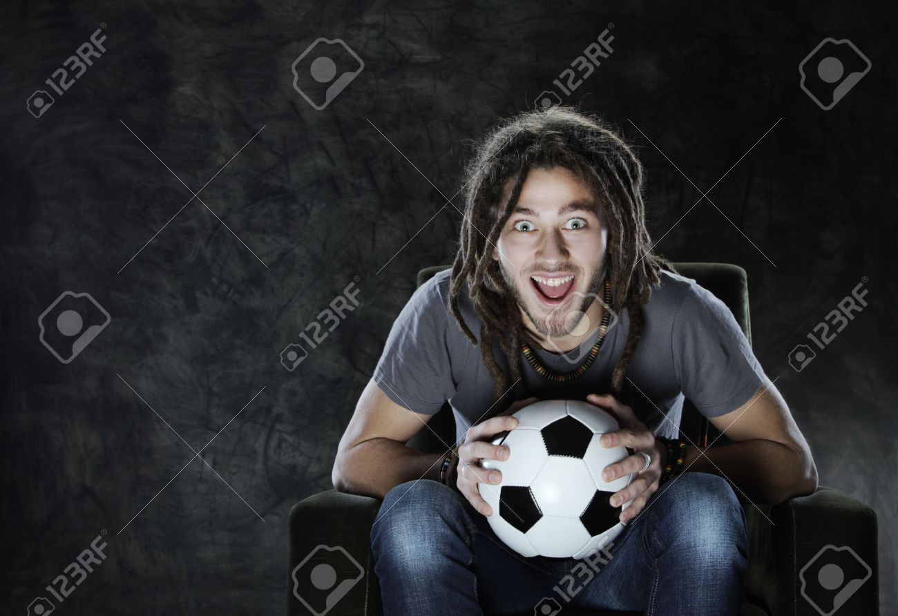 Young adult man exults watching football on television: Goal! Stock Photo - 18057384