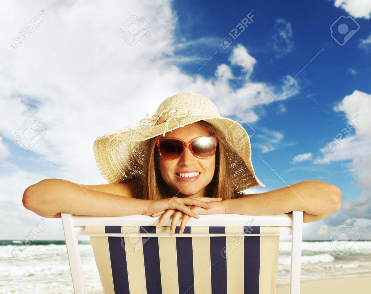 Beautiful young woman relaxing on beach chair Stock Photo - 18057379