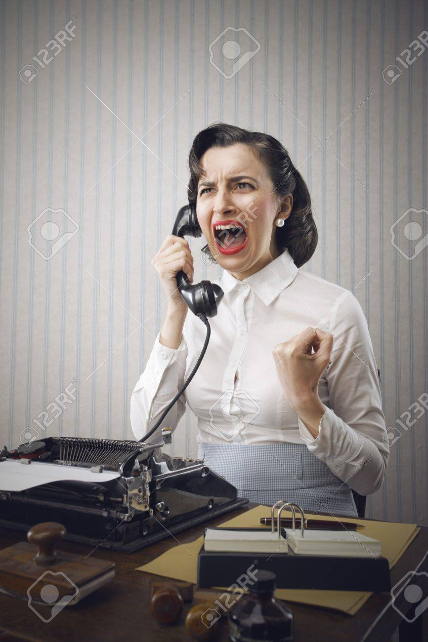 Young Business woman shouting into telephone Stock Photo - 18530491