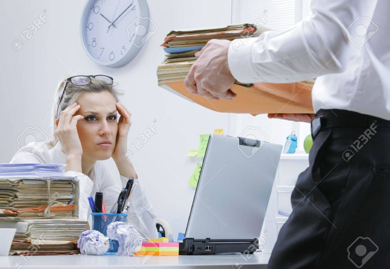tired businessw a too much paperwork and documents stock stock photo tired businessw a too much paperwork and documents