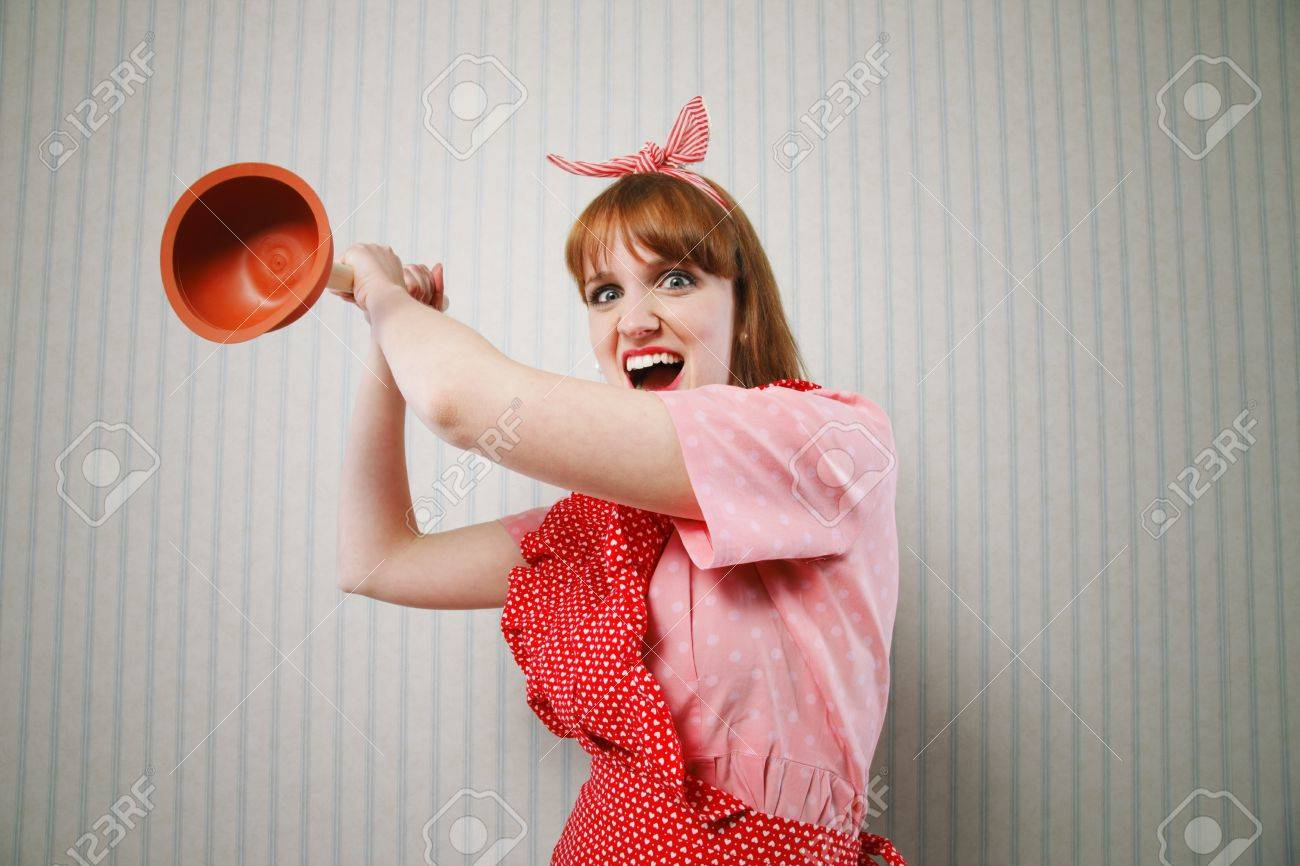 Angry housewife with tool to clean toilettes Stock Photo - 19167069
