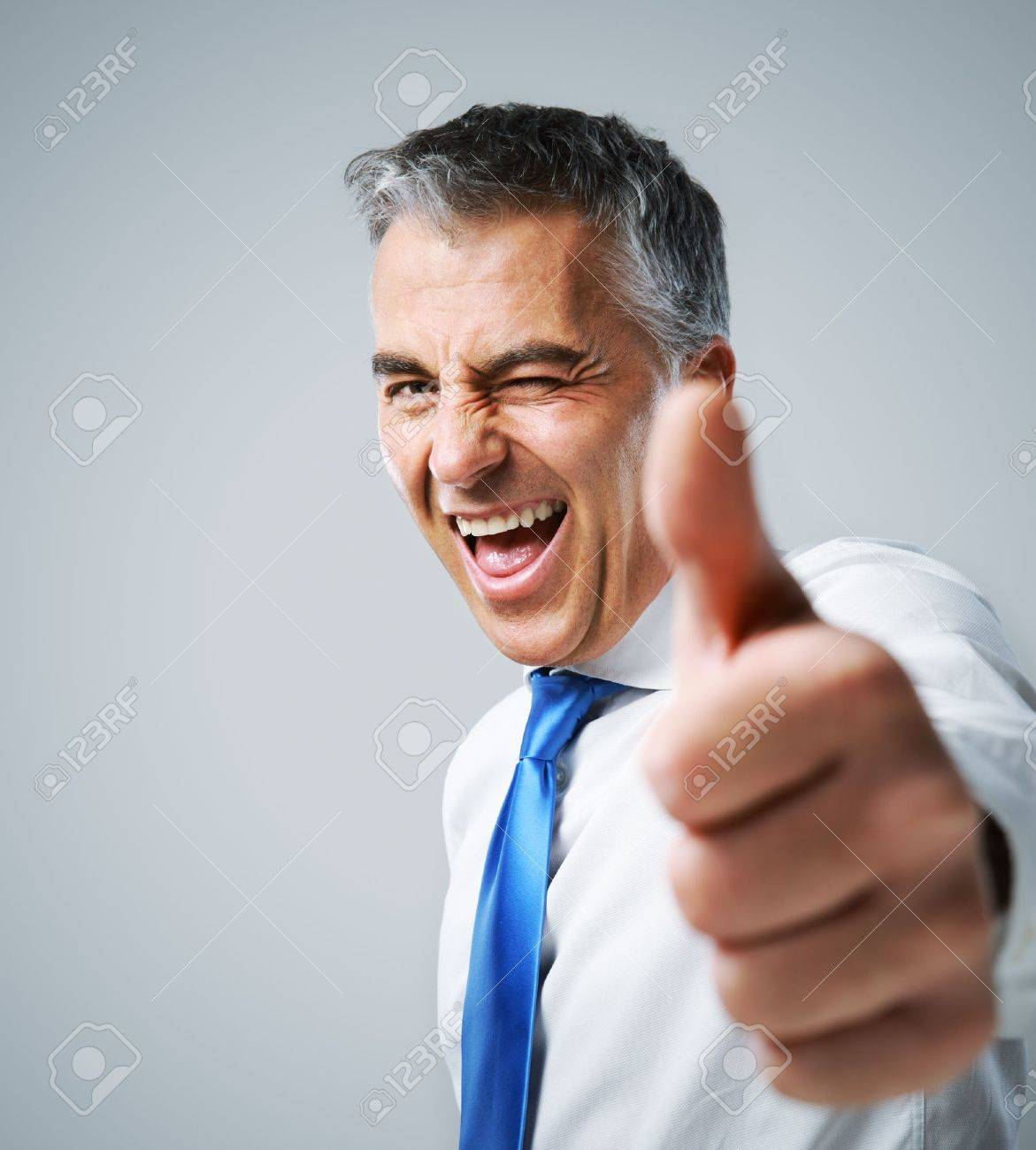 happy mature business man showing thumbs up sign stock photo