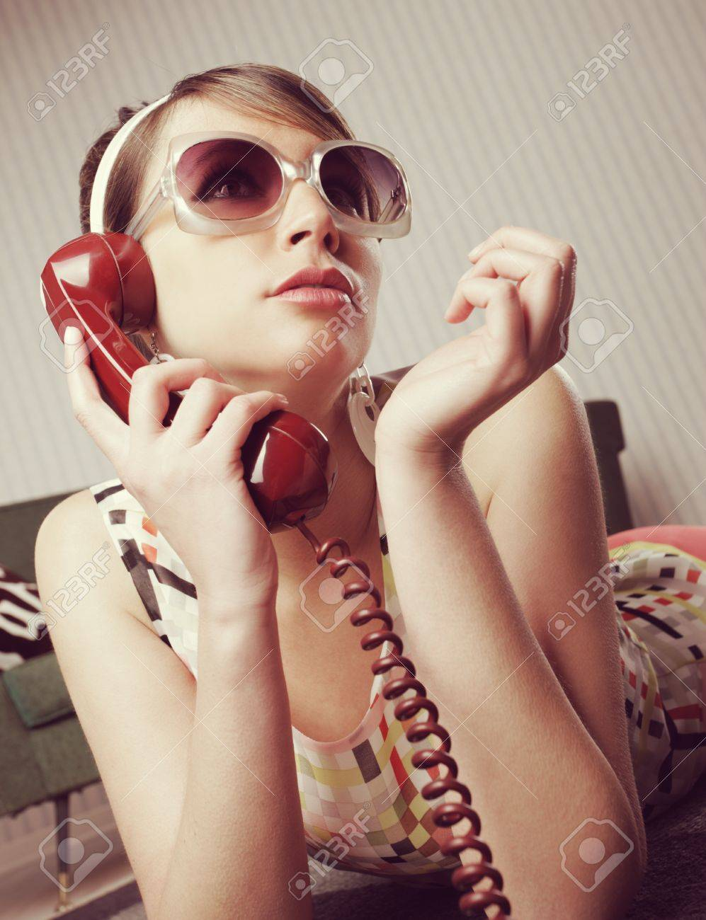 Fashion model talking on the phone at home Stock Photo - 21510575