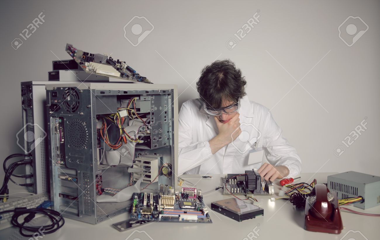 Computer technician is trying to repair a computer Stock Photo - 21772455