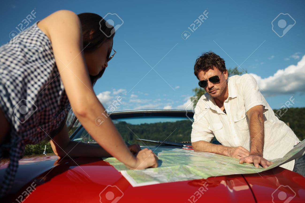 Beautiful couple trying to find their way Stock Photo - 21888595