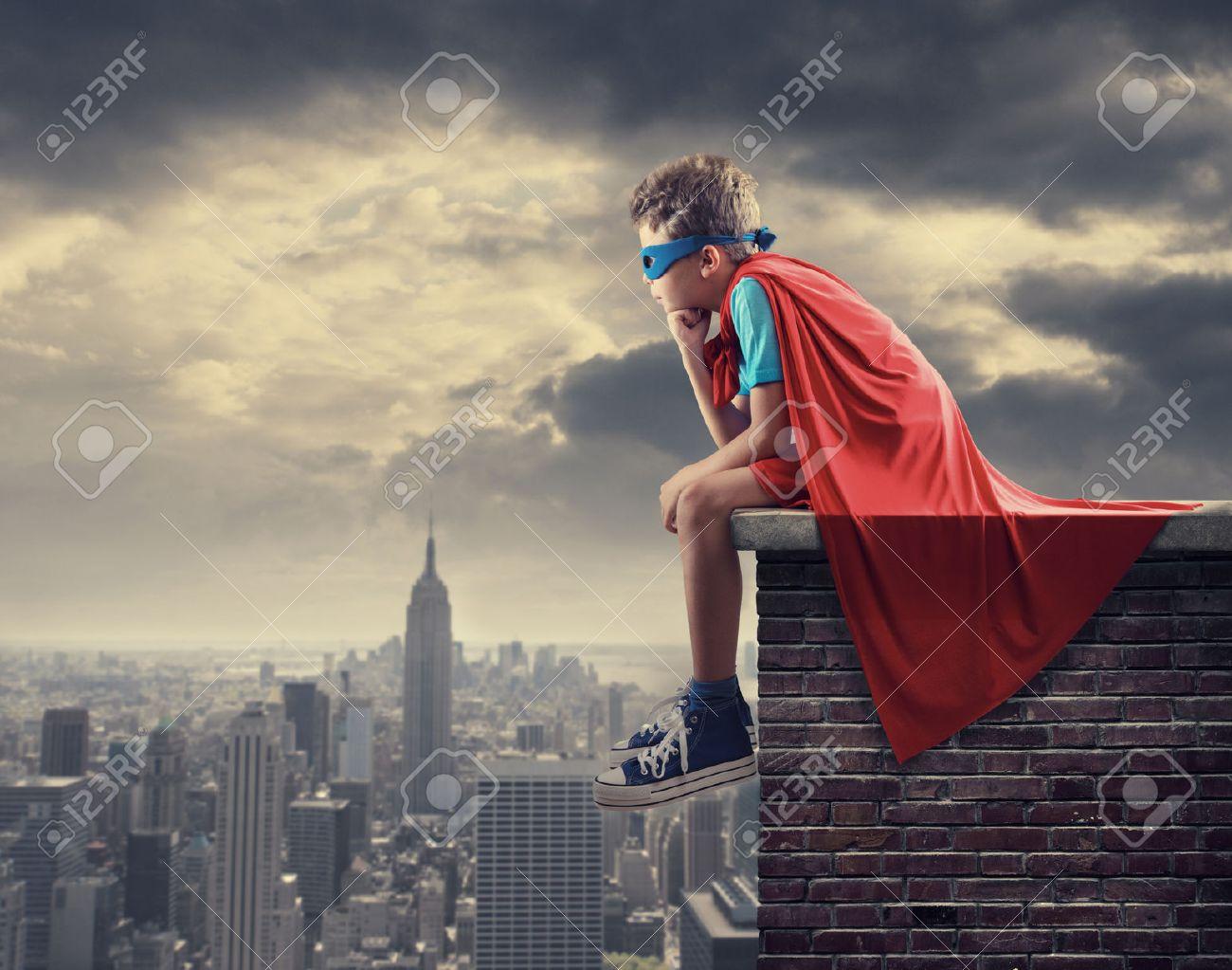 A young boy dreams of becoming a superhero. - 22427996