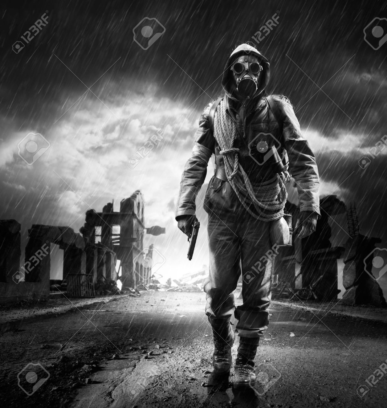 A lonely hero wearing gas mask walking through a city destroyed - 22809869