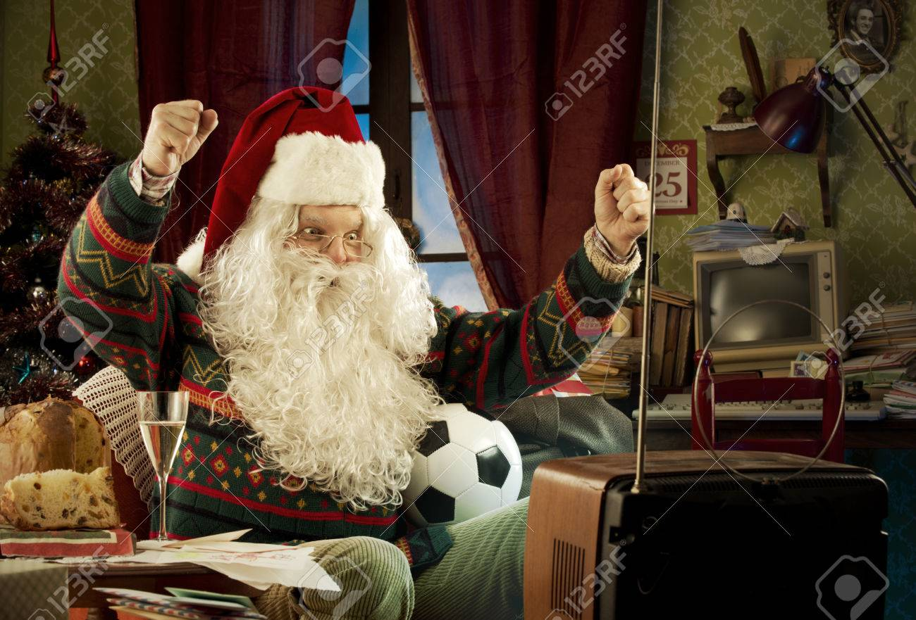 Santa Claus watching a soccer match on tv Stock Photo - 22997576
