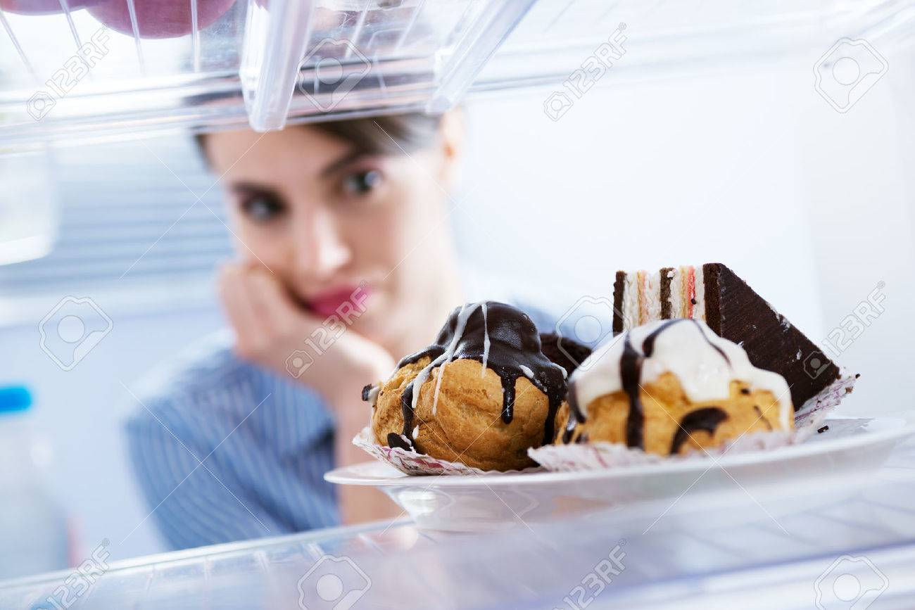 Young Hungry Woman In Front Of Refrigerator Craving Chocolate ...