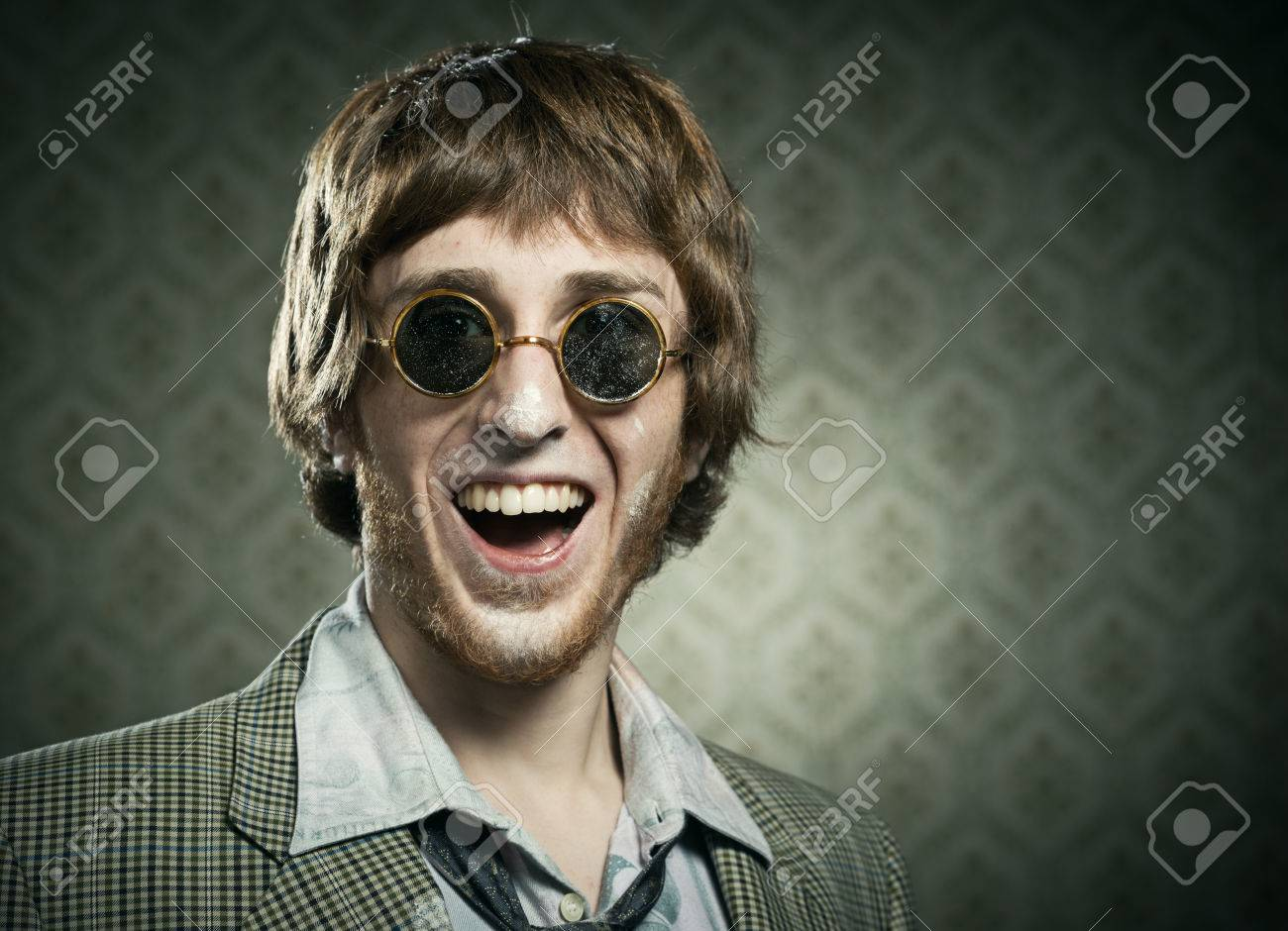 Funny 1960s Style Guy After Snorting Cocaine On Vintage Wallpaper Background Stock Photo
