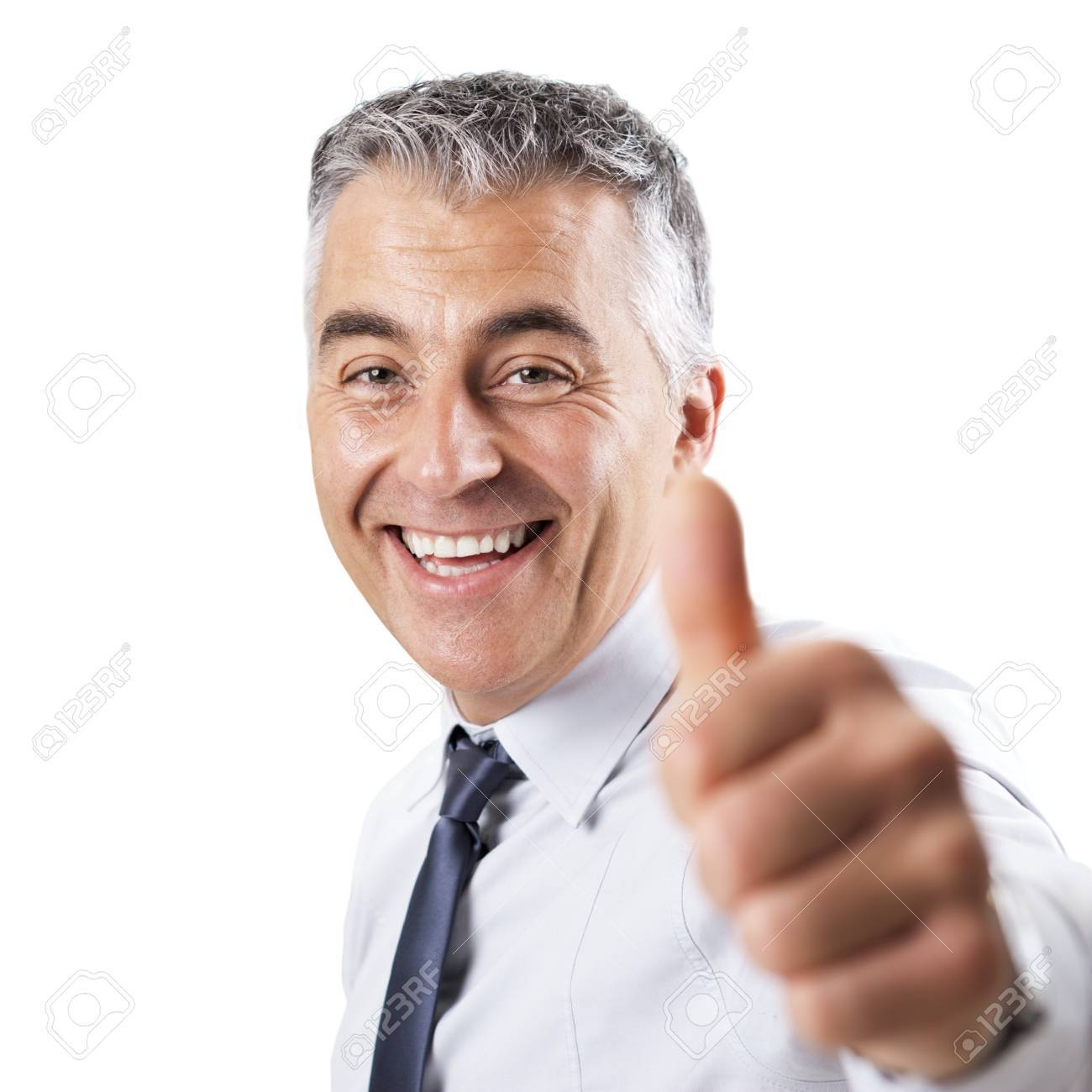 smiling confident businessman tumbs up on white background stock