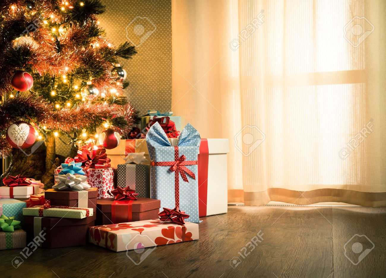 Elegant christmas tree with decorations and gifts on elegant..