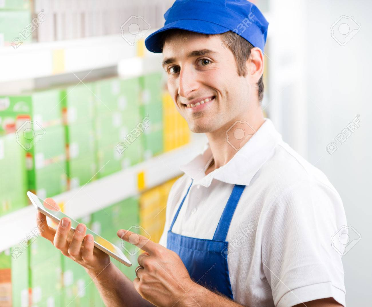 s clerk stock photos pictures royalty s clerk s clerk young s clerk holding a digital tablet and working at supermarket