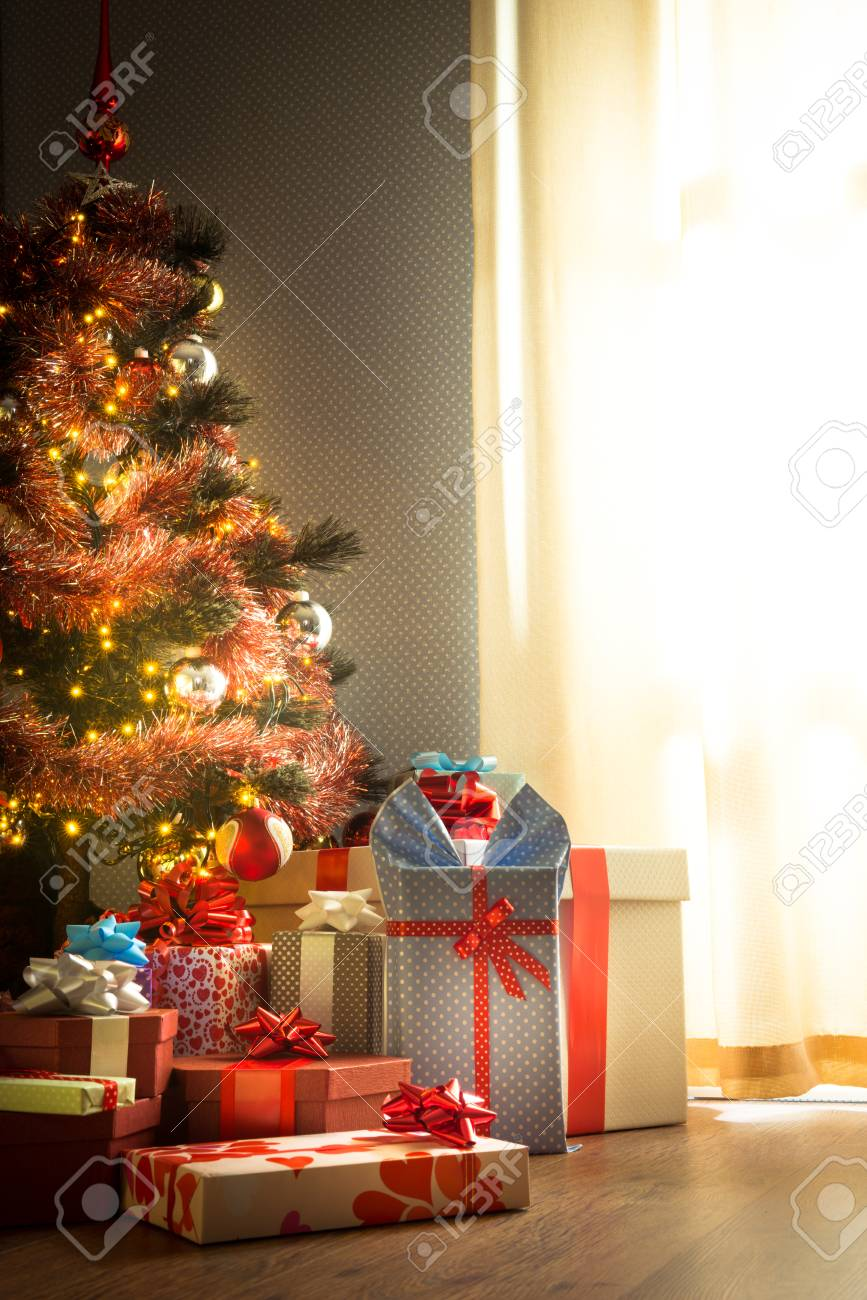 Home Interior With Christmas Tree And Colorful Gifts Next To Stock Photo Picture And Royalty Free Image Image 33049187