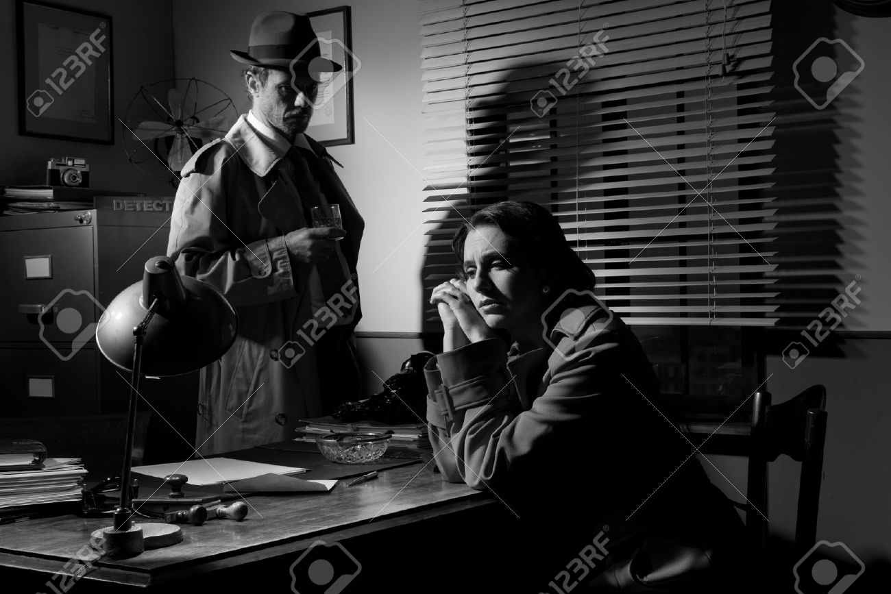 Detective interviewing a young sad woman in his office film.. stock
