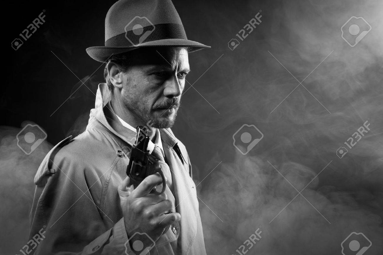 united states good texture dirt cheap Handsome detective in trench coat holding a gun in the dark,..