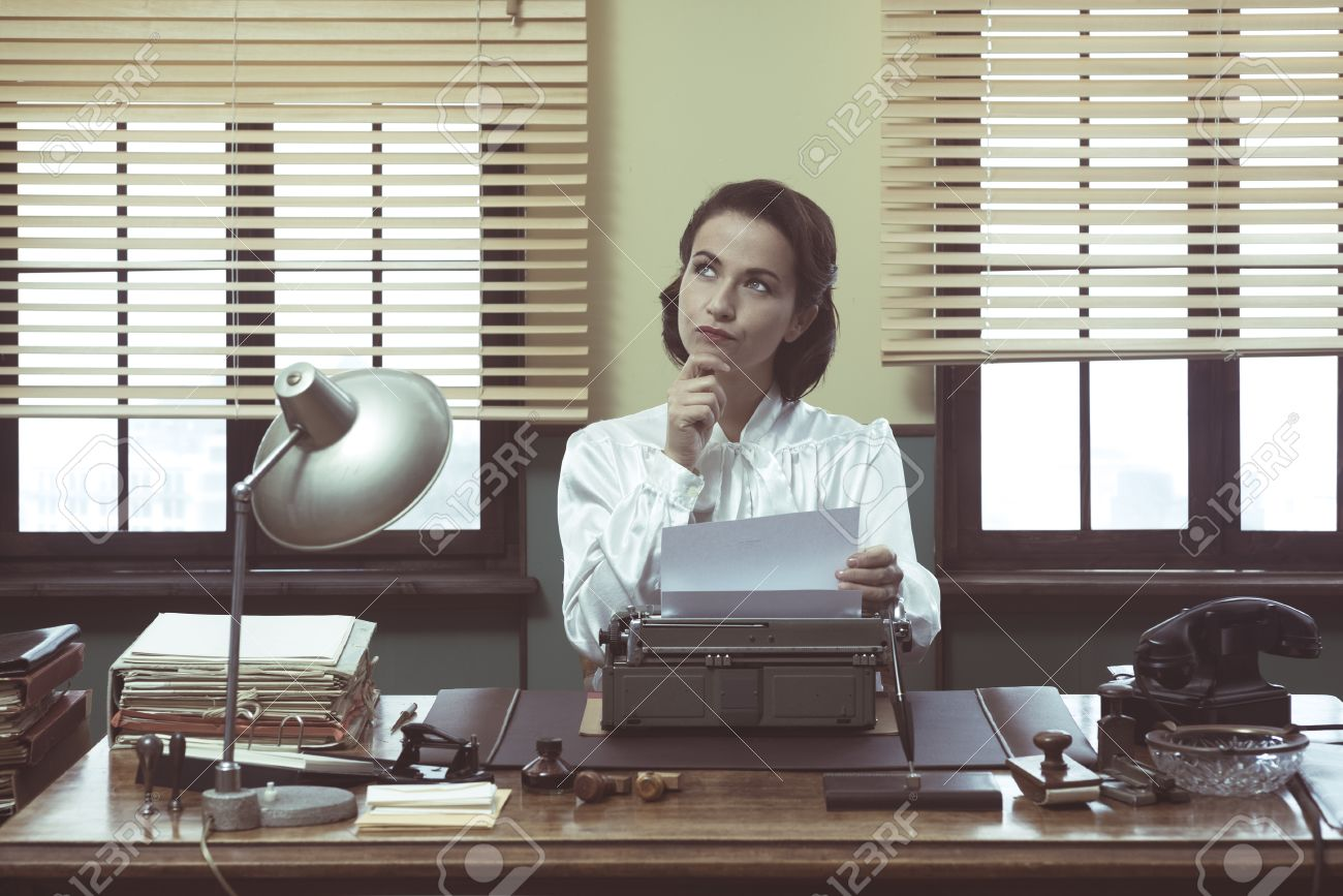 writer job stock photos pictures royalty writer job images writer job pensive vintage w hand on chin typing on typewriter and looking