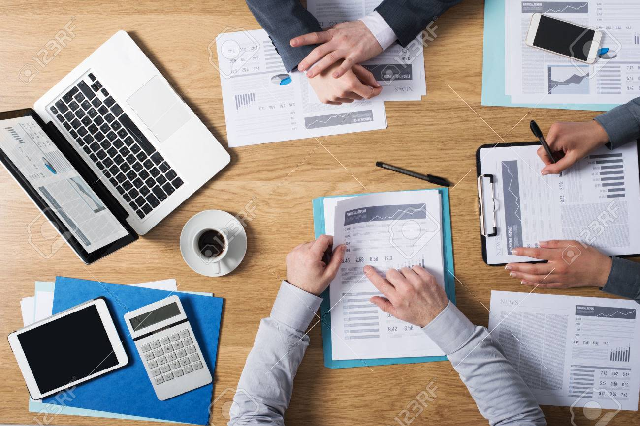 Business people team working together at office desk with laptop tablet financial paperwork and reports top view Stock Photo - 39447129