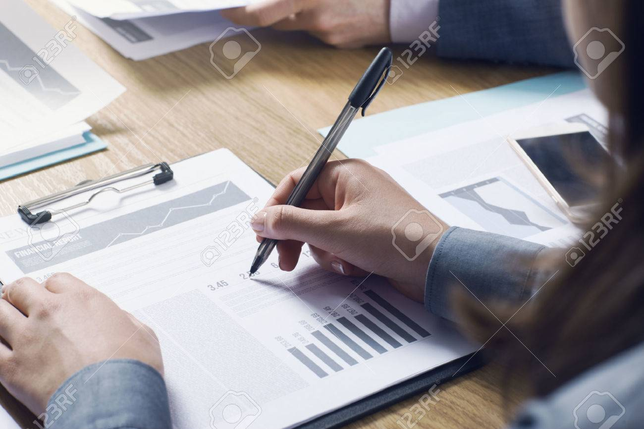 Business people team working together at office desk with financial data and paperwork teamwork concept Stock Photo - 39447130