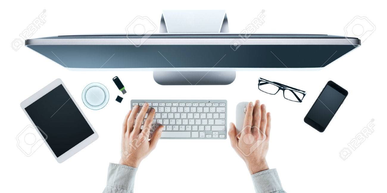 Businessman working at computer at office desk, hands close up top view, white background Stock Photo - 41135075