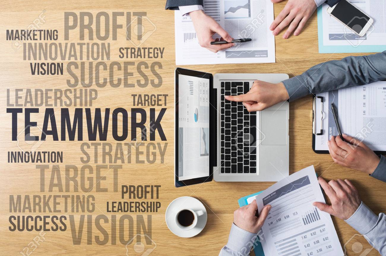 Business team hands at work with financial reports and a laptop, marketing and strategy concepts on the left, top view Stock Photo - 41135192