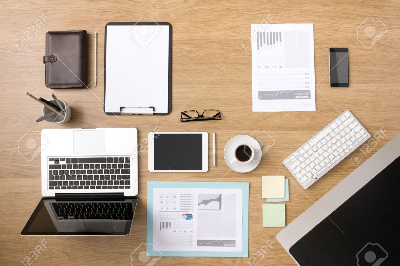 businessman s tidy desktop and work tools with paperwork computer