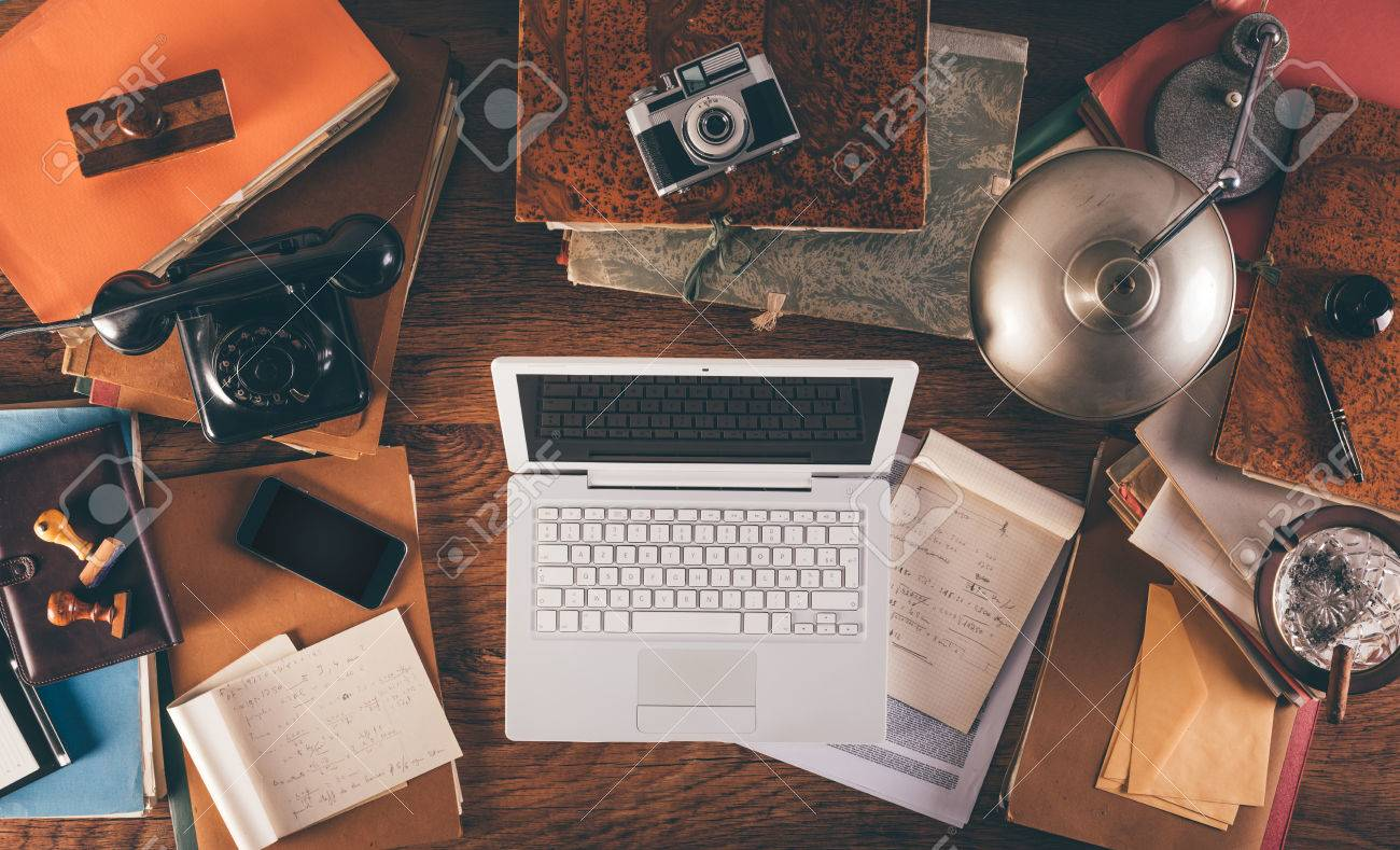 Table lamp stock photos pictures royalty free table lamp images table lamp messy vintage desktop with laptop phone lamp camera and folders geotapseo Gallery