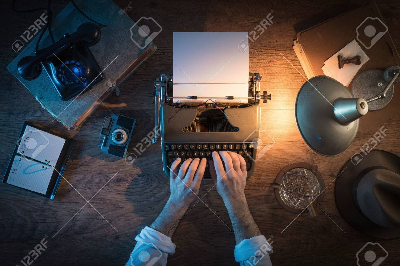 Vintage journalist's desk 1950s style, he is working and typing on his typewriter late at night, top view Stock Photo - 43569278