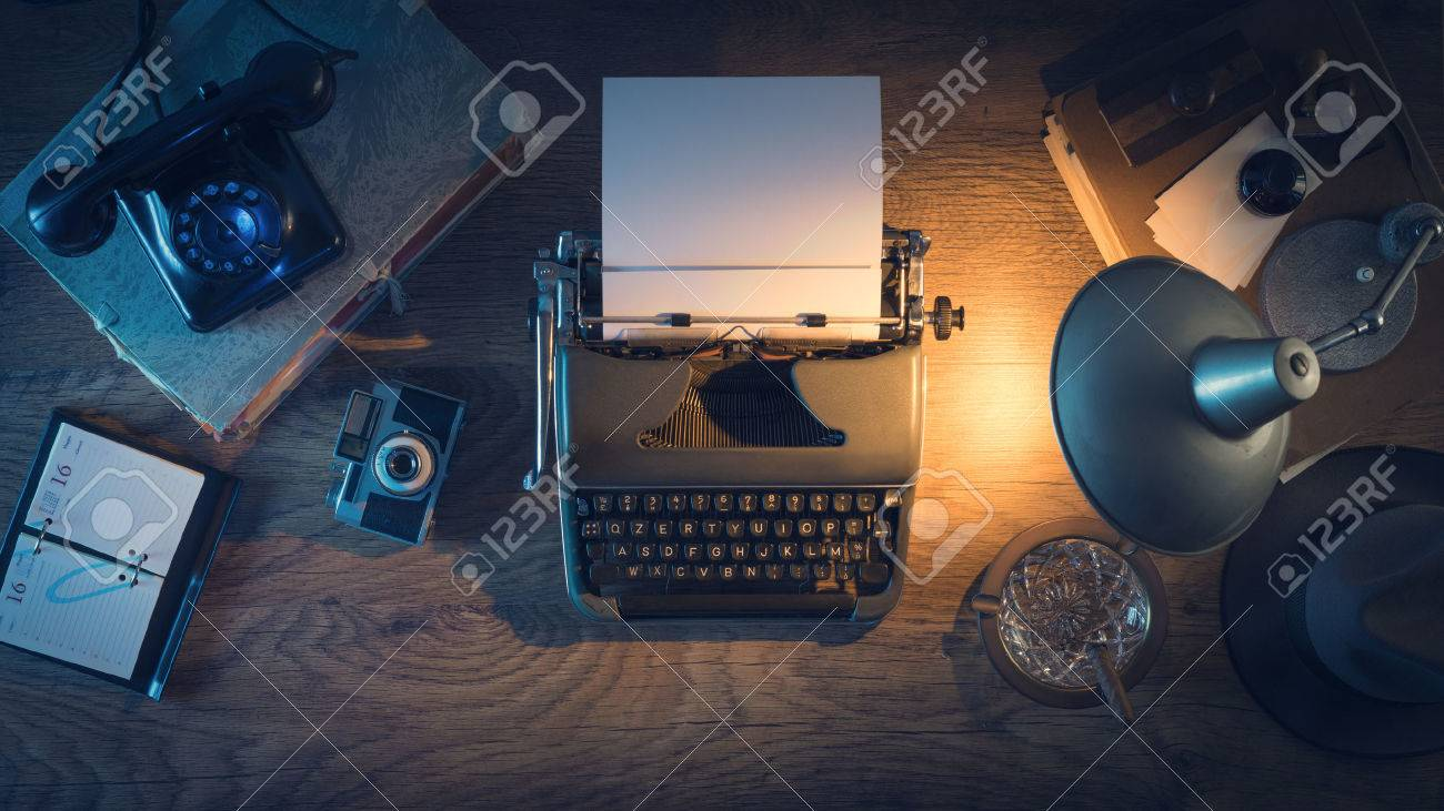 Retro journalist's desk 1950s style with vintage typewriter, phone and lamp at night time, top view Stock Photo - 43569271