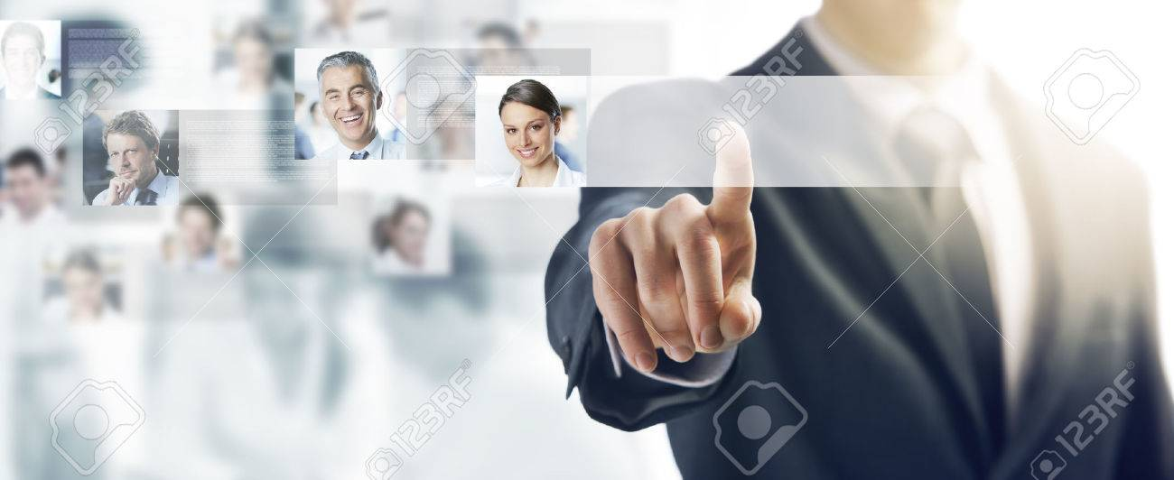 Businessman using a touch screen interface and pushing a button, people avatars and business team on background Stock Photo - 43016280