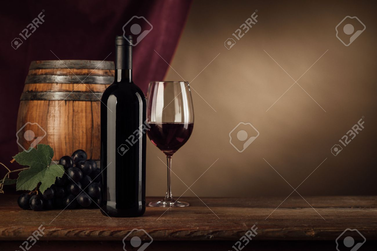 Red wine tasting with bottle wineglass barrel and grape on the cellar wooden table & Red Wine Tasting With Bottle Wineglass Barrel And Grape On.. Stock ...