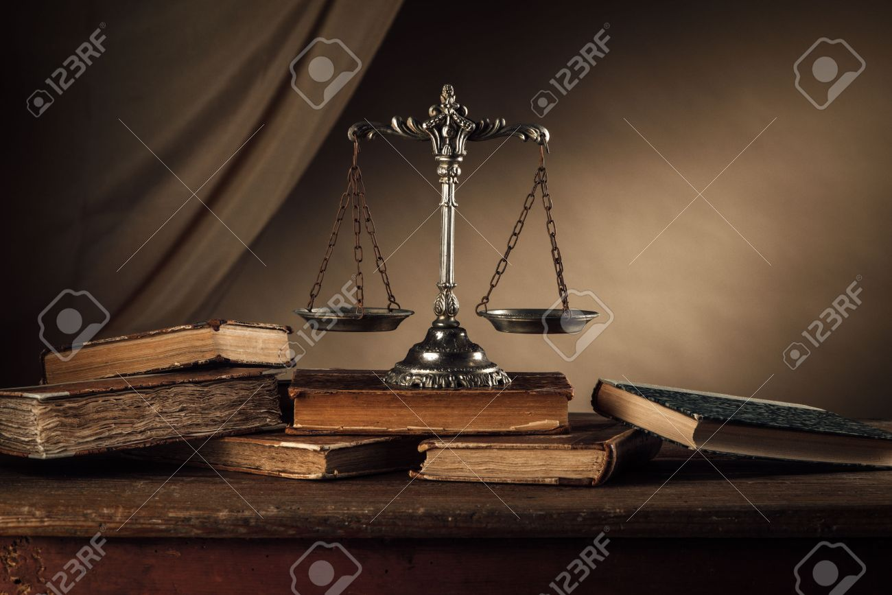 Old silver scale and hardcover books on a wooden table, justice and knowledge concept Stock Photo - 46510488
