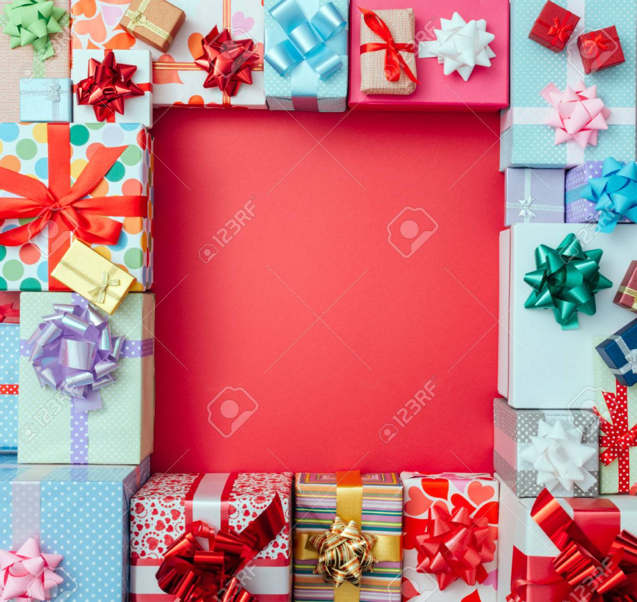 Colorful gift boxes framing a red blank copy space on a desktop, top view, Christmas and celebrations concept Stock Photo - 48492522