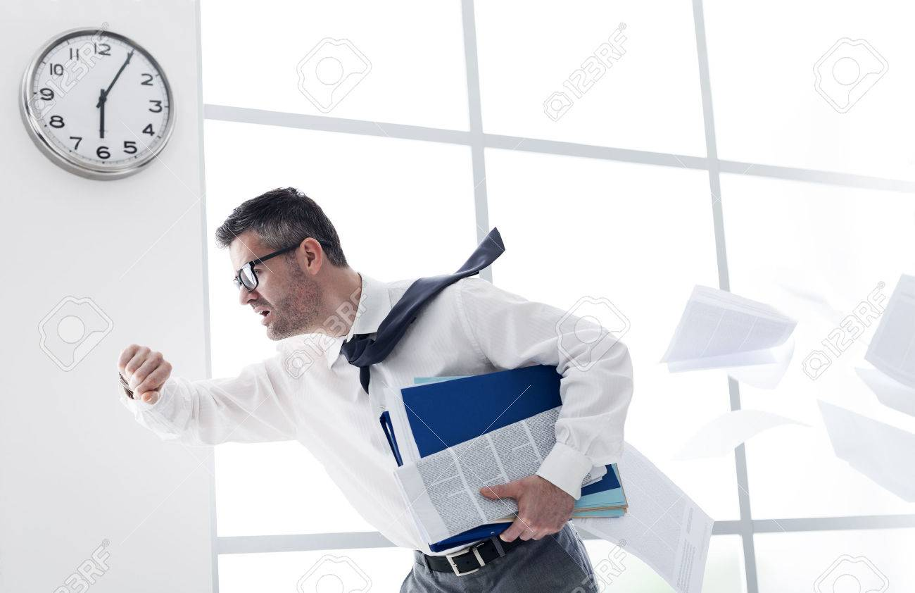 Stressed anxious businessman in a hurry checking time and running, he is late for his business appointment Stock Photo - 54081371