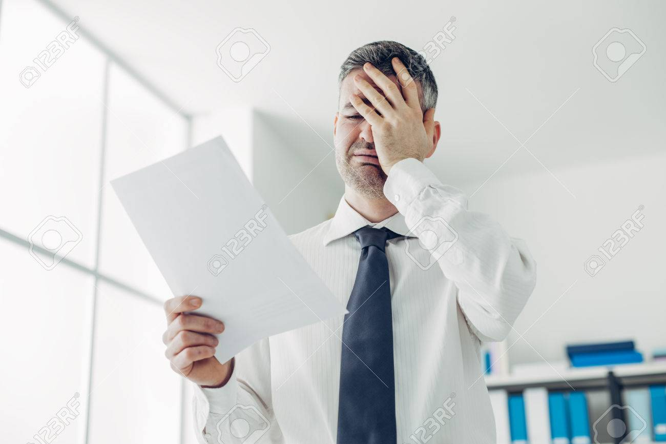 Desperate office worker receiving a dismissal letter from his boss, loss of job and unemployment stress concept Stock Photo - 54081906