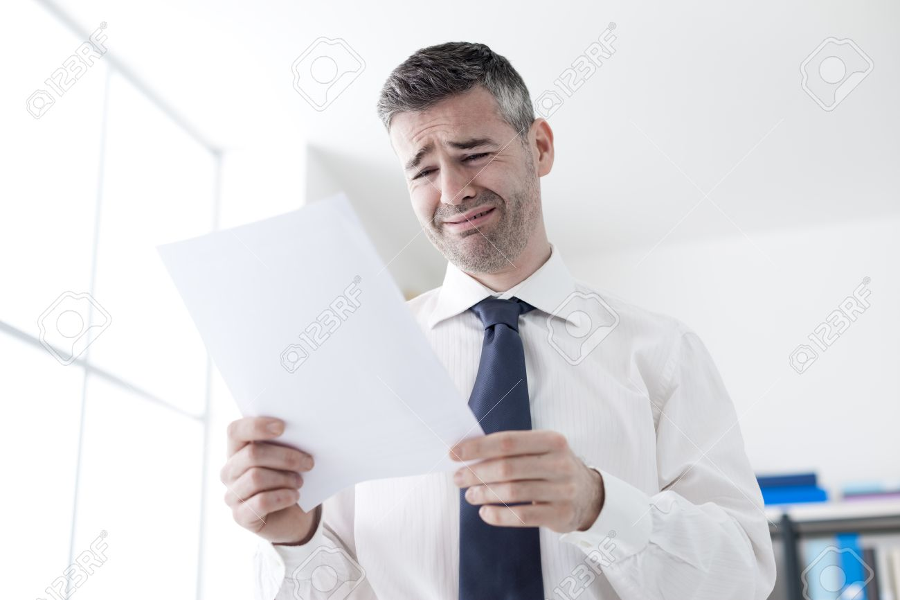 desperate office worker receiving a dismissal letter from his desperate office worker receiving a dismissal letter from his boss loss of job and unemployment