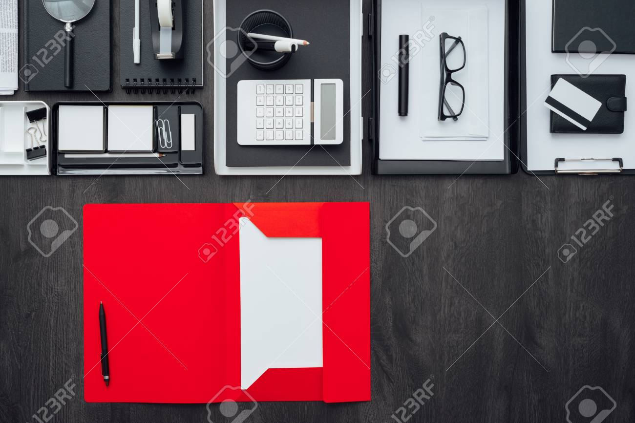 corporate business desktop with office accessories and open folder