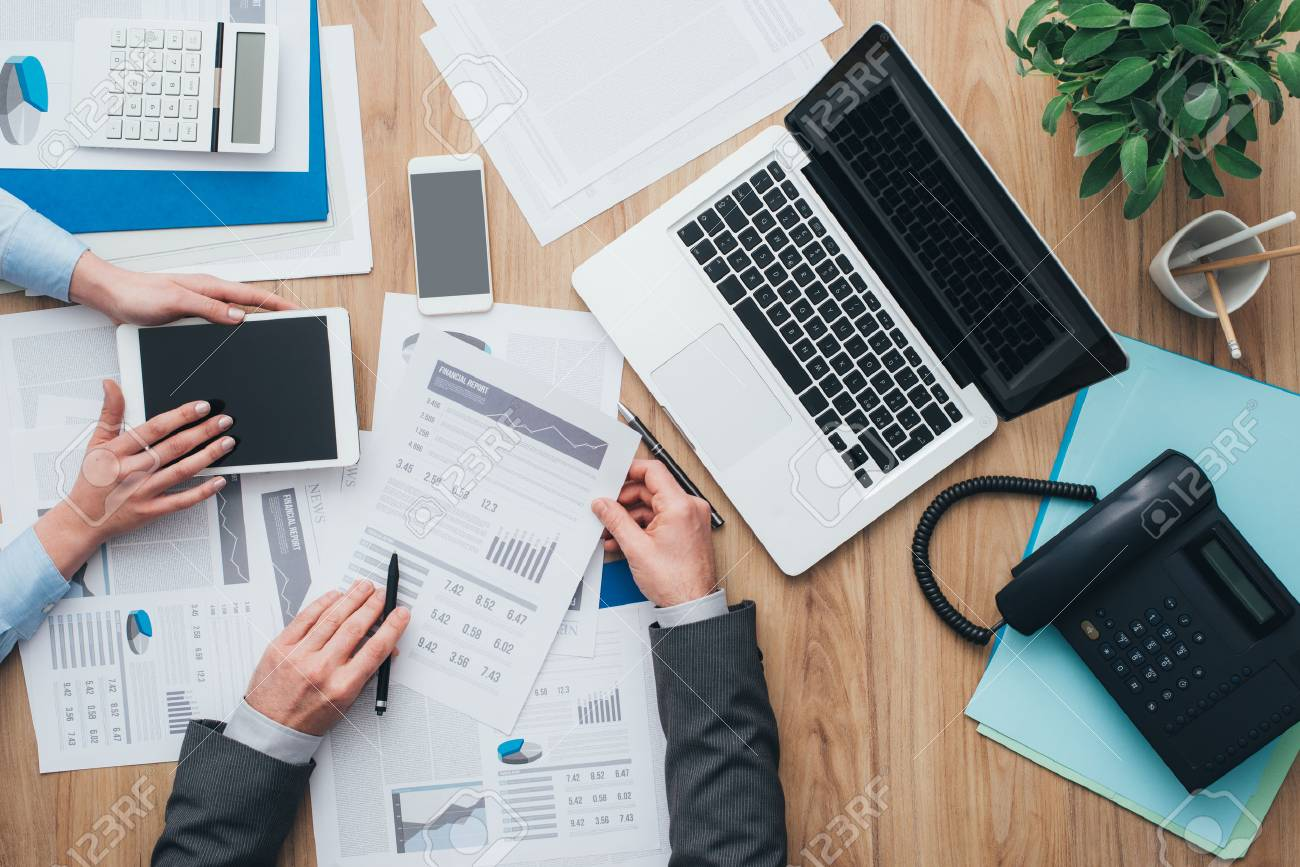 Business Team Working At Office Desk And Analyzing Financial Reports,  Finance And Accounting Concept, Top View Stock Photo, Picture And Royalty  Free Image. Image 67045141.