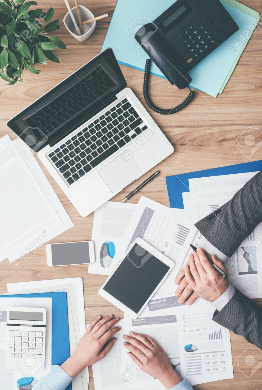 Business Team Working At Office Desk And Analyzing Financial Reports,  Finance And Accounting Concept, Top View Stock Photo, Picture And Royalty  Free Image. Image 84205267.