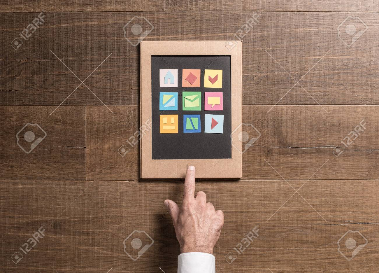 Man using an eco friendly creative tablet made from recycled man using an eco friendly creative tablet made from recycled cardboard and paper cuts jeuxipadfo Image collections