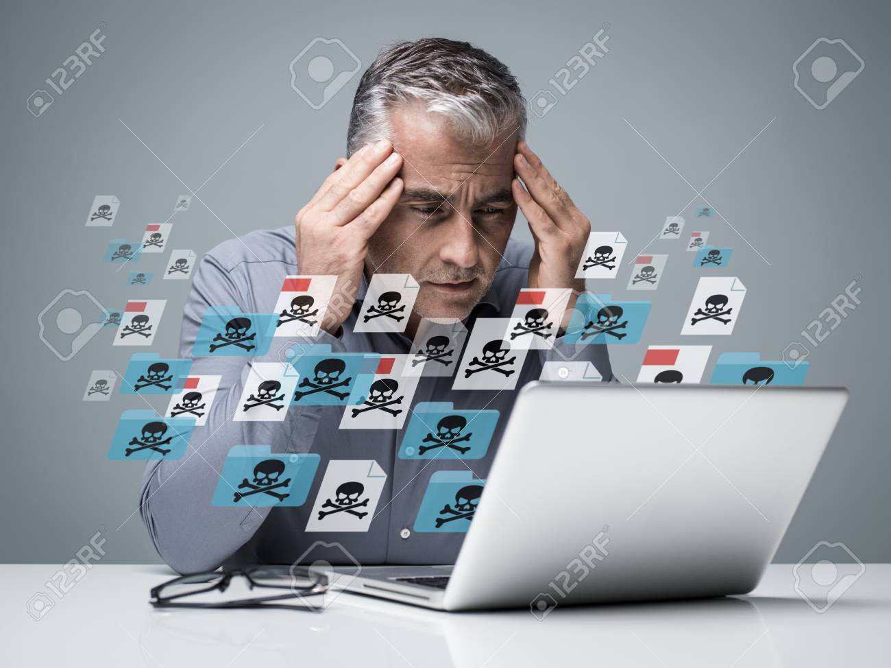 Businessman working with a computer full of viruses, infected files and malwares: he is frustrated with head in hands - 88355487