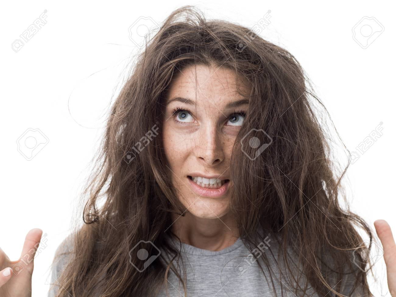 Angry Young Woman Having A Bad Hair Day Her Long Hair Is Messy