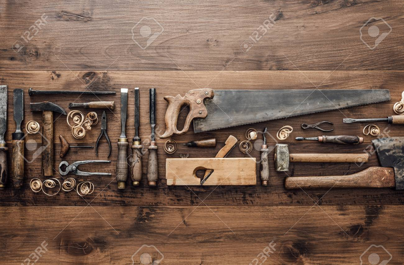 Collection of vintage woodworking tools on a rough workbench and blank copy space: carpentry, craftsmanship and handwork concept, flat lay - 89418213