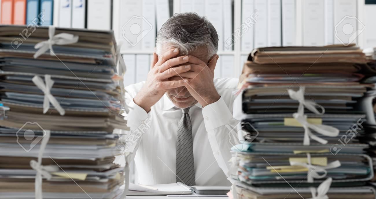 Image result for overburdened bureaucrat