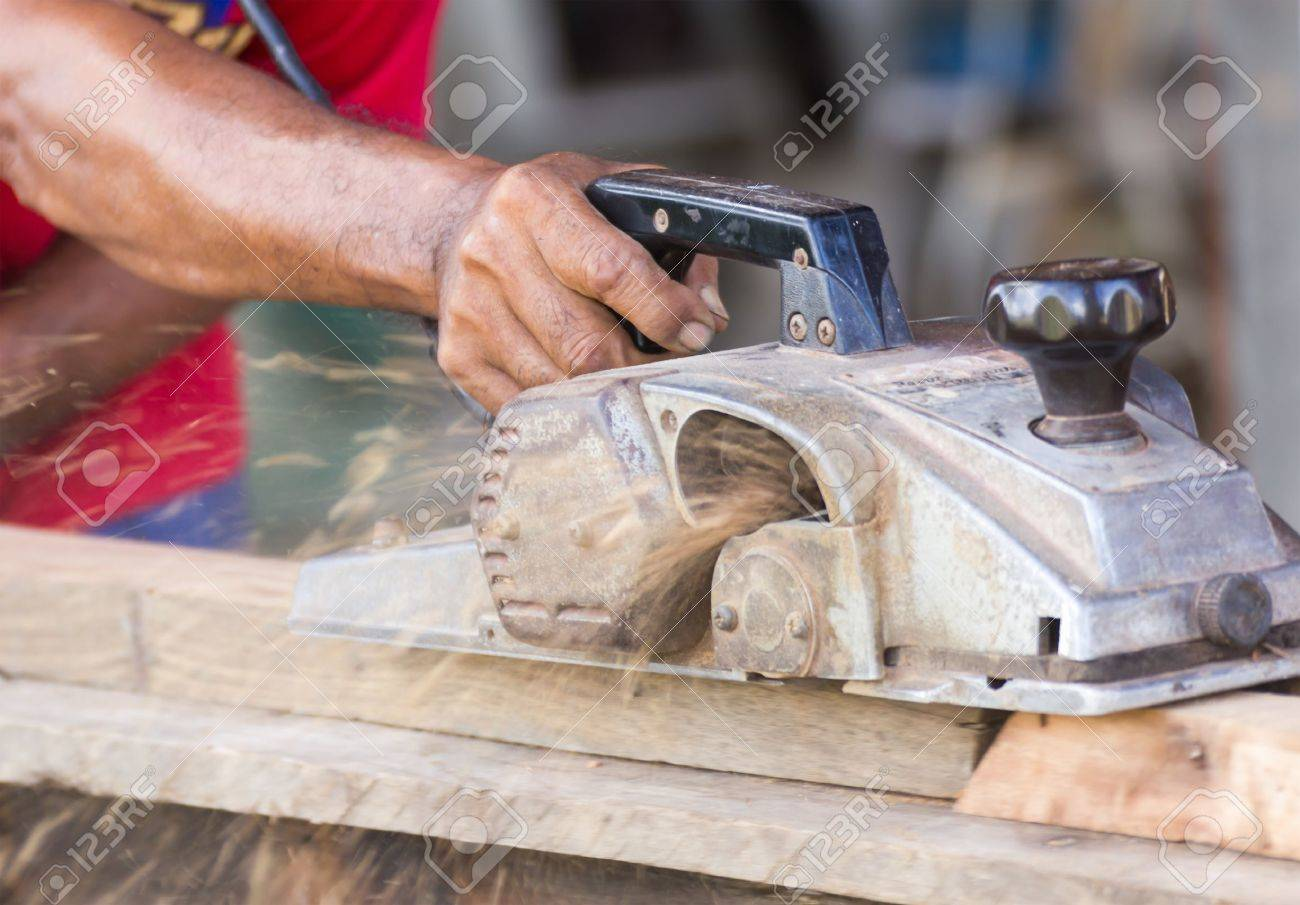 Carpenter working with electric planer  in his workshop, close up on the tool with hands Stock Photo - 16231852