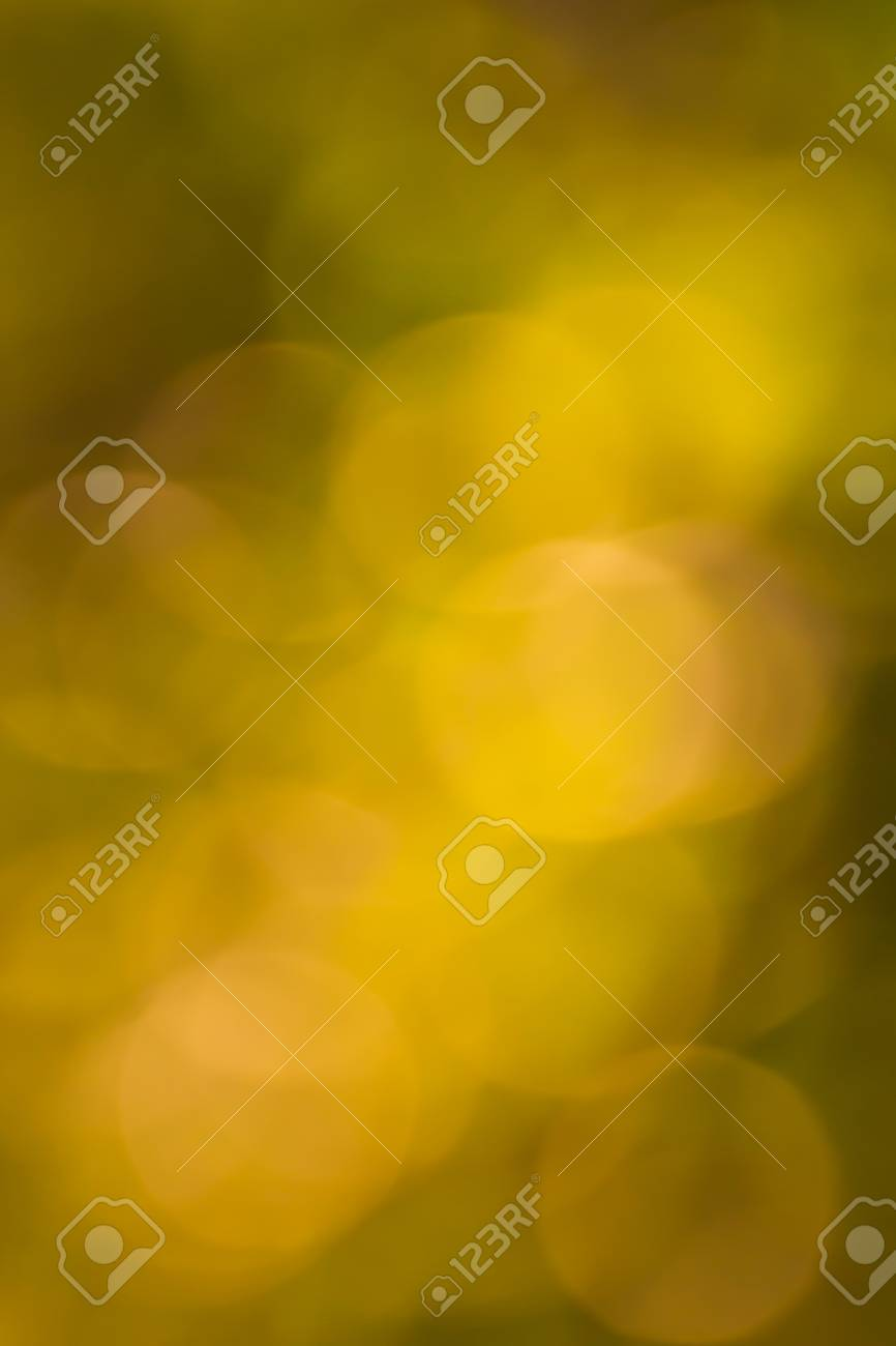 Blurred lights yellow bokeh abstract light background Stock Photo - 19821624